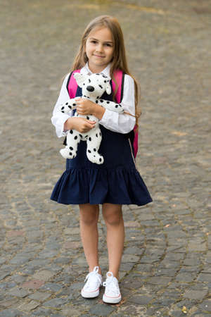 Play and learning go hand-in-hand. Happy kid play with toy dog outdoors. Child development and learning. Preschool education. Playschool and daycare. Creativity and imagination. Social skills