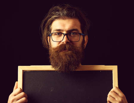 smiling hipster in glasses