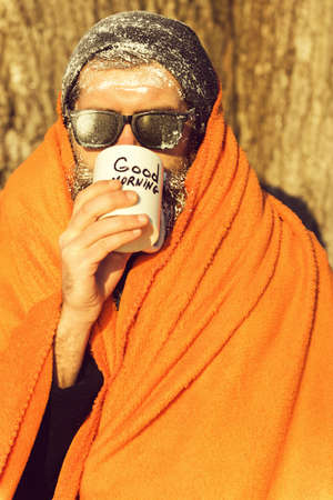 Man in blanket with cup