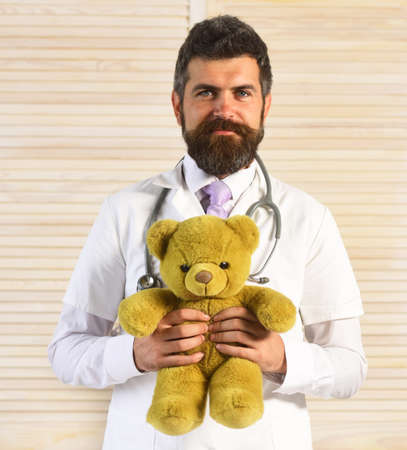 Man in surgical uniform with stethoscope on neck and toy Stock fotó