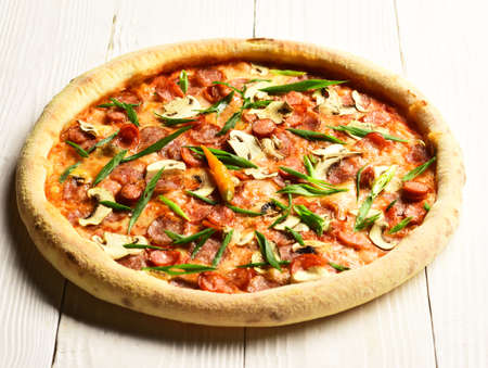 Spicy pizza with chili peppers. Takeaway food with crunchy edges
