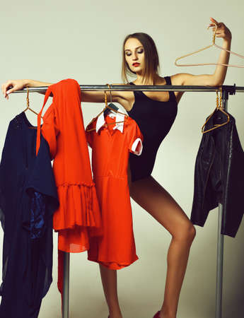 Pretty girl with sexi red lips in bodysuit with hanger Stok Fotoğraf