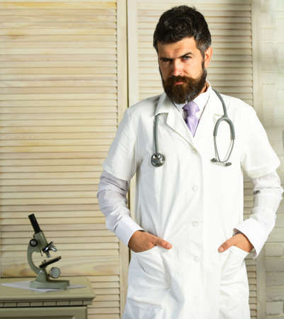 Physician with strict face ready to diagnose. Healthcare and treatment