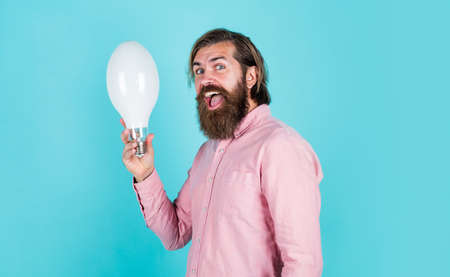 man just inspired. economy of electricity. bright minded hipster. creative inspiration. light your way. bearded man with bulb. smiling man hold big lamp. got new idea. concept of creativity