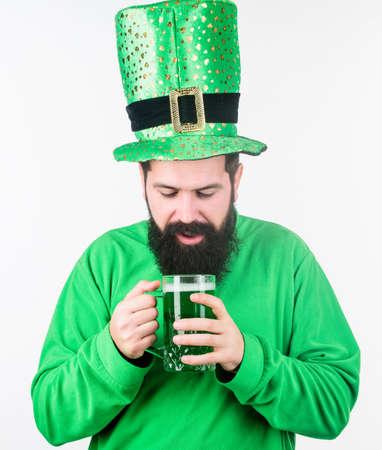 Irish pub. Green beer mug. Drinking beer part of celebration. Bar special offer. Alcohol consumption integral part saint patricks day. Irish tradition. Man brutal bearded hipster drink pint beer