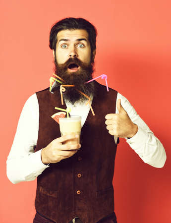 surprised handsome bearded man on red studio background