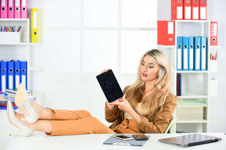 Accounting online. sexy designer student. freelancer business woman with tablet computer. woman with tablet in office. millennial girl browsing internet. attractive businesswoman using digital tablet