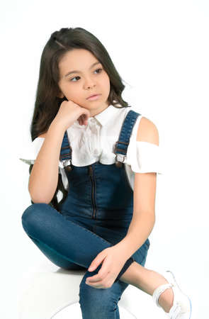 Preteen model with thinking face on blue background
