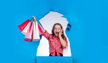 great news. teen girl carry heavy shopping bags. presents in packages. big sale offer. school market sale began. real shopaholic. concept of black friday. final sell-out. happy kid go shopping