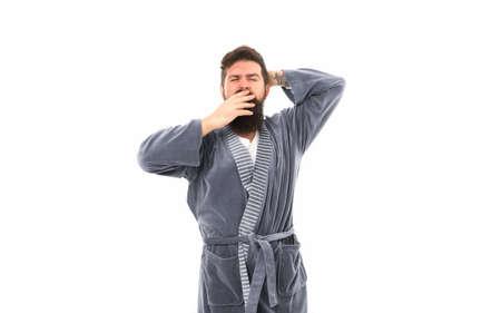 Feeling sleepy. Sleepy hipster yawn isolated on white. Bearded man look sleepy in bathrobe. Early morning time. Good night. Home clothing. Awakening. Being lazy and sleepy