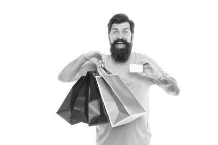 Happy man shopping. Payment method. Bank card. Black friday sale. Satisfied customer. Easier than ever. Contactless payment. Credit card. Bearded man with bags and discount card. Purchase concept Stock fotó