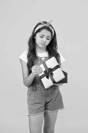 upset by the contents inside. Not what I expected. dont like the gift. boxing day concept. shopping for kids. retro child wear summer headband. sad girl received present box. Oh no