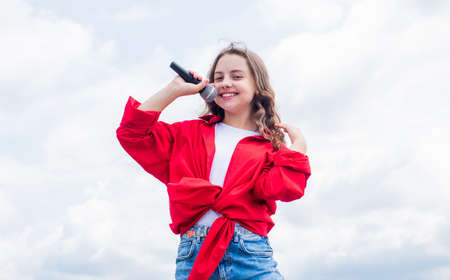 treets are singing. happy singer with microphone. girl singing. vocal school concept. karaoke club. music is my life. kid sing with mic. cheerful event manager. child have fun on party Stock fotó - 154911402