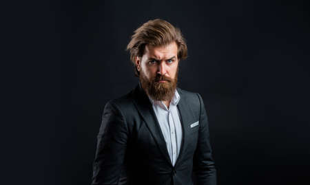 bride groom. mens office wardrobe. fashionable man dressed in suit. formal fashion model. handsome man on gray background. serious bearded businessman. stylish mature man looking modern