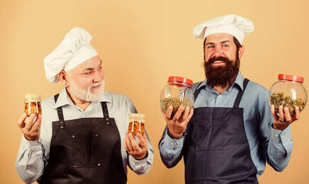 Cooking healthy. cheerful men hold food ingredients. prepare food. cuisine concept. healthy eating. professional cook. mature senior bearded men in kitchen. Chef men cooking Stock fotó - 154911518