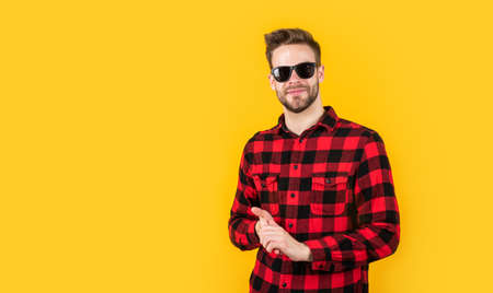 male beauty trend. bearded man with sexy bristle in glasses. facial hair and skin care. handsome man wear checkered shirt. unshaven guy in casual style. male hairdresser and barbershop. copy space