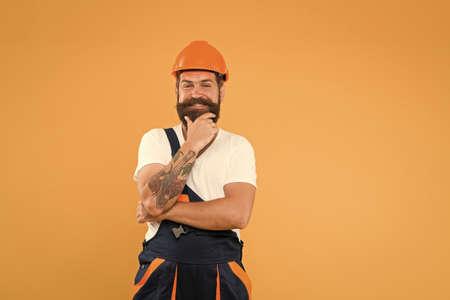 Polished approach. Craftsman keep head safe in helmet. Improvement and renovation. Brutal man builder. Engineer builder in uniform. Man builder hard hat. Handyman at workshop. Creativity and practice Stock fotó
