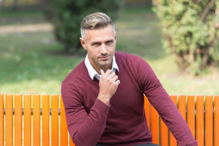 confident businessman has groomed hair and elegant look, style