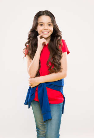 Change you can see. Styling curly hair. Hairdresser tip. Kid girl long healthy shiny hair. Perfect curls. Kid cute face with adorable curly hairstyle. Little girl grow long hair. Teen fashion model Stock fotó