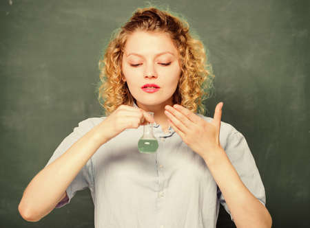 Girl observing chemical reaction chalkboard background. Explore chemistry. Chemistry lesson. Chemistry lab. Interesting and fascinating. Woman teacher performing experiment with bulb and liquid