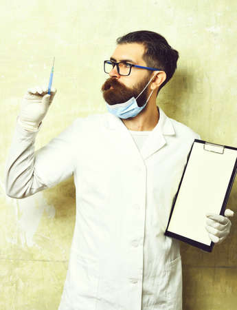 Bearded brutal caucasian doctor or postgraduate student holding clipboard Stock Photo