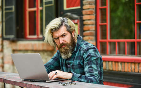 mature student working on computer. go shopping on cyber monday. bearded man hipster in cafe with laptop. online distant education. hipster inspired to work. agile business. Modern school