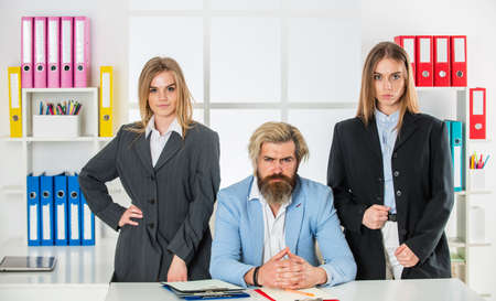 Successful team. modern office life. together in business. businesspeople in office. businessman and businesswoman at workplace. too much work with documents. business partnership success