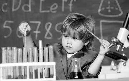 Boy test tubes liquids chemistry. Chemical analysis. Kid study chemistry. Biotechnology and pharmacy. Genius pupil. Education concept. Wunderkind experimenting with chemistry. Talented scientist