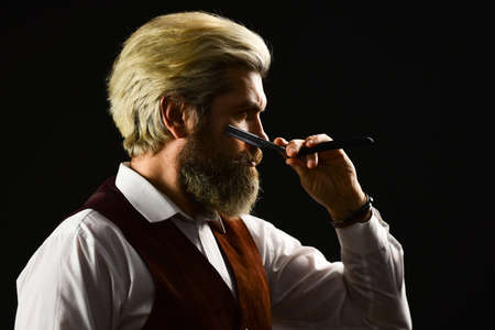 Barbershop. Barbershop services. Keep yourself looking groomed all year round. Hipster Barber. Vintage style man with beard and moustache. Mature man with dyed hair. Vintage barbershop. Barber tools