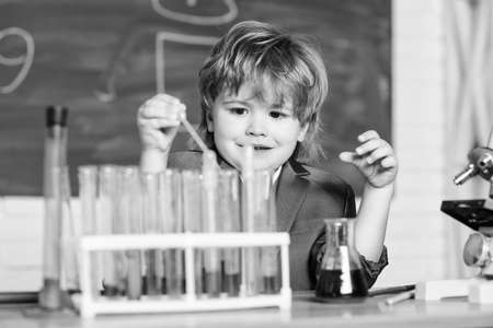 Kid study chemistry. Biotechnology and pharmacy. Genius pupil. Chemical analysis. Science concept. Wunderkind experimenting with chemistry. Boy use microscope test tubes chemistry school classroom
