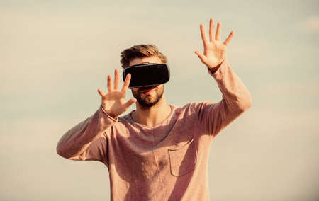 Man explore VR sky background. VR technology and future. VR communication. Exciting impressions. Gaming and entertainment. Interaction with digital surface. Gesture control. 3d visualization Stock fotó - 155433587