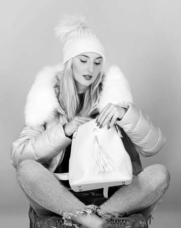 ready to go. warm winter clothing. shopping. flu and cold season. Leather bag fashion. girl in puffed coat. faux fur fashion. happy winter holidays. woman in beanie hat with backpack 免版税图像
