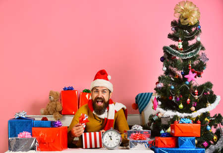 Santa holds gift box. Man with beard and happy face Stock Photo