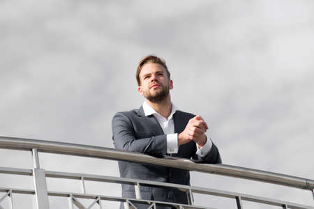 Man in formal wear stand on cloudy blue sky. Confident businessman outdoor. Looking to the future. Thinking about new possibilities. Male fashion look. Best manager ever. Confidence and charisma