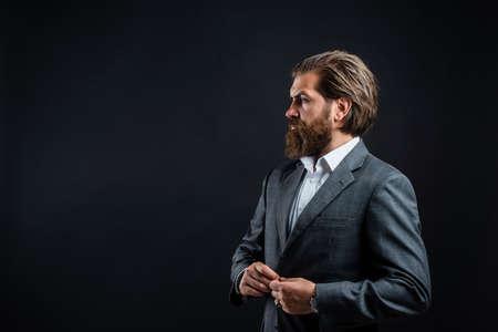 Man with beard wear grey suit corporate style, public speaker concept