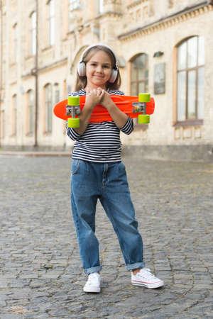 New adventure awaits. Happy kid hold penny board outdoors. Aboveground transportation. Adventure travel. Childhood activites. Traveling and wanderlust. Summer vacation. Sport and recreation
