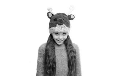 Cheerful kid. Playful cutie. Adorable baby wear cute winter knitted deer hat. Cute reindeer with red nose. Cute accessories. Girl wear winter theme accessory. Christmas carnival. Fun and joy Stock Photo
