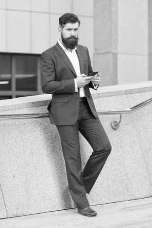 Send message. Mobile communication. Contact list. Handsome cool businessman using smartphone