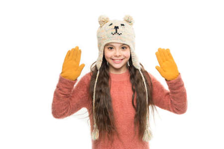 Wool is delicate. let it snow. ski resort. get ready for winter holiday. homemade knit. little playful girl in winter look smiling. Fashion concept. cute beauty isolated on white. warm in any weather