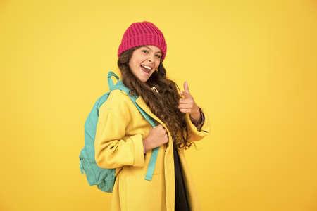 Madcap concept. Teen age. Girl adorable stylish modern teenager. Teen spirit. Rebellious teen. Street style. Rebel teen girl. Cool schoolgirl. Have fun charismatic girl on yellow background Stock Photo