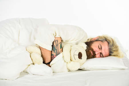 so lovely. Toys shop concept. playing in bed. mature man has childish habits. cute and romantic playful adult. brutal male express tenderness to teddy bear toy. sweet dreams. Present for partner