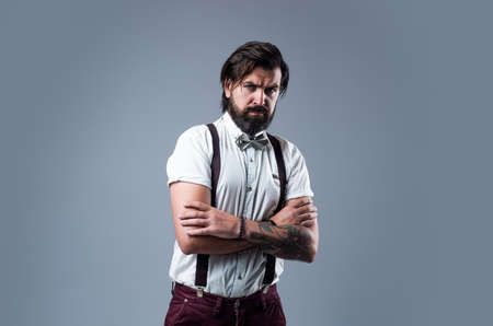 true confidence. barbershop. mature barber in retro style. bearded man in suspenders. brutal guy wear bow tie. elegant male fashion look. handsome hipster in formal wear. party goer Stock fotó