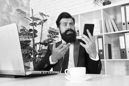 Modern life. Businessman read sms in mobile phone. Mobile technology. Mobile lifestyle. Business communication. Running business makes him to be mobile Reklamní fotografie