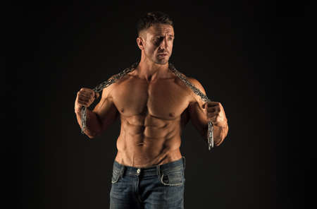 Remove shackles. Strong enough to be free. Bodybuilder concept. Healthy and strong. Masculine sport. Improve yourself. Man muscular athlete. Macho handsome muscular torso. Attractive muscular body