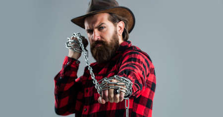 You matter. handsome man with beard hold chain. concept of freedom. man chained problems. liberation from slavery. perfect male charisma. caucasian man with powerful metal chain in hands Stock Photo