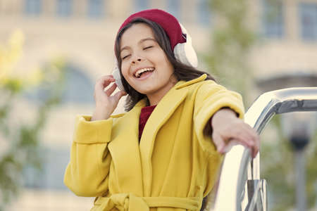 imagination. autumn fashion. school fall season. little girl child listen audio book. little girl in headset. online education. music lover. ebook technology. cheerful parisian girl in french beret