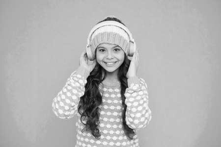 Favorite band. Girl long hair listen music headphones. Hobby concept. Winter holidays. Winter music chart. Winter playlist. Entertain herself. Recording studio. Beautiful voice. Developing voice