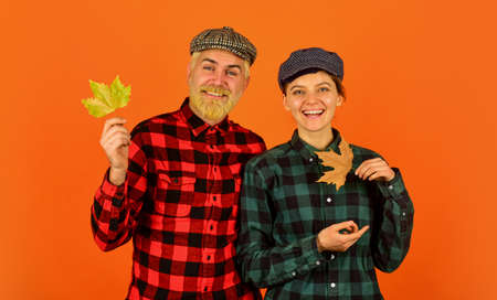 Farmers market. Autumn mood. Couple in love checkered rustic outfit. Retro style. Cheerful smiling couple dating. Fall season. Autumn leaves. Farmer family concept. Autumn is coming to our village