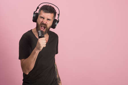 Dj with beard wears headphones. Music and leisure concept.