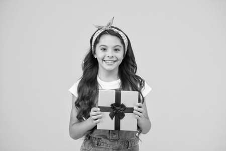 Surprise and present box. Child smiling happy hold gift box. Kid girl delighted gift. Childrens day. This is for you. Celebrate birthday. Kid birthday gift. Extra bonus. Grateful for good gift Stock Photo